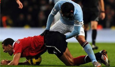 Carlos Tevez fists Rio Ferdinand