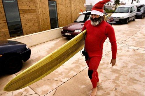 surfing santa claus